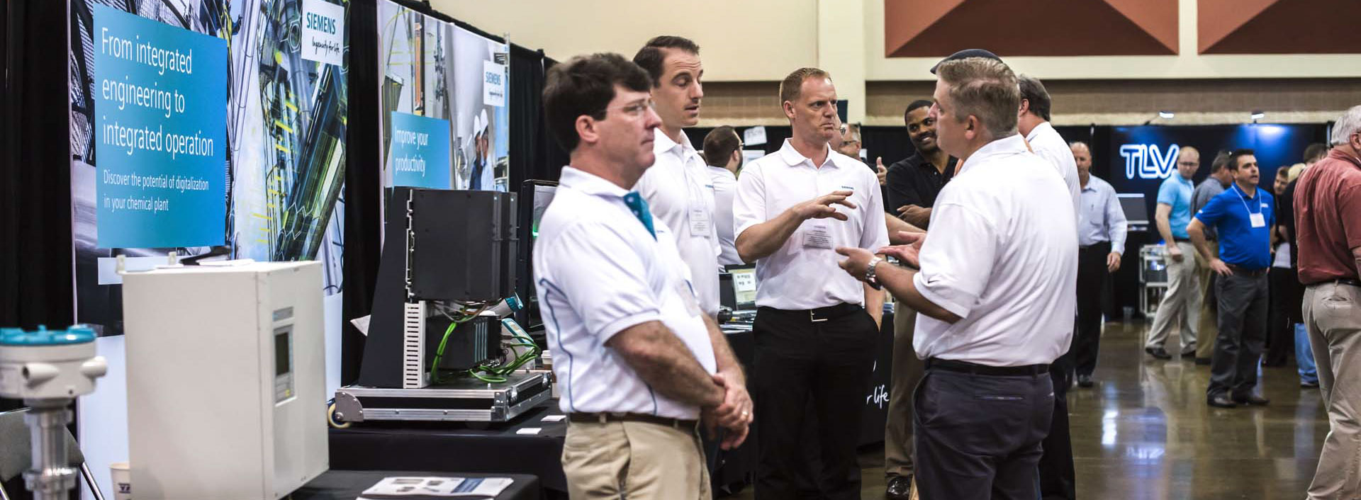 Spirited discussion of the future of plants prevailed at the Siemens booth on the eChem Expo exhibit floor.