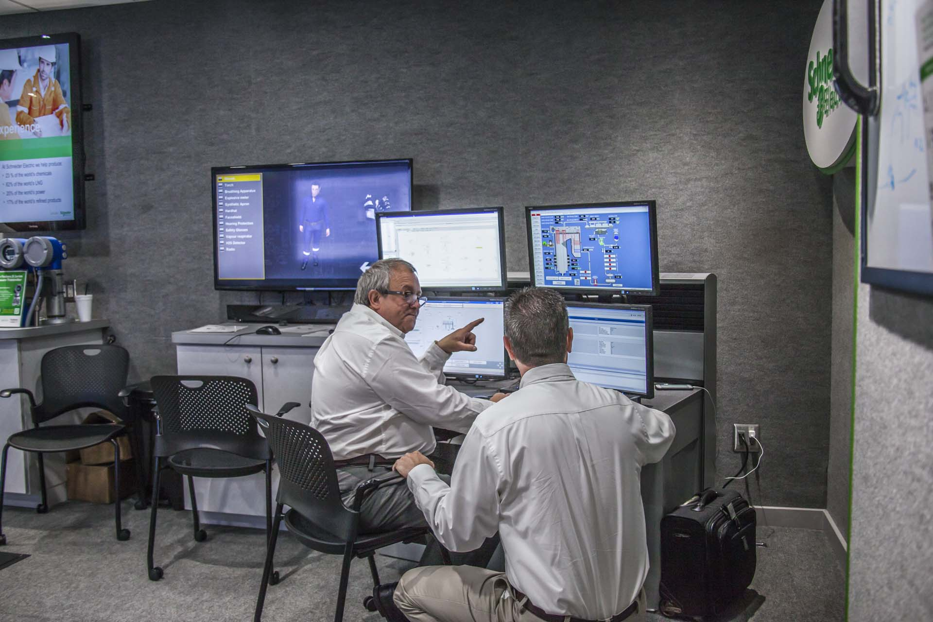 Engineers used computers in the Schneider Electric trailer to discuss new process simulation tools and the future of plant technology.